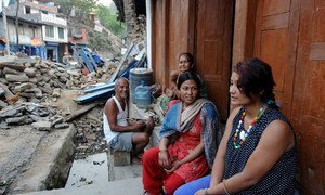 A female community health volunteer Sarita Shrestha (centre) checks in on a 22-year-old pregnant woman Bizu Shrestha outside her house in Sindhupalchowk district, Nepal.