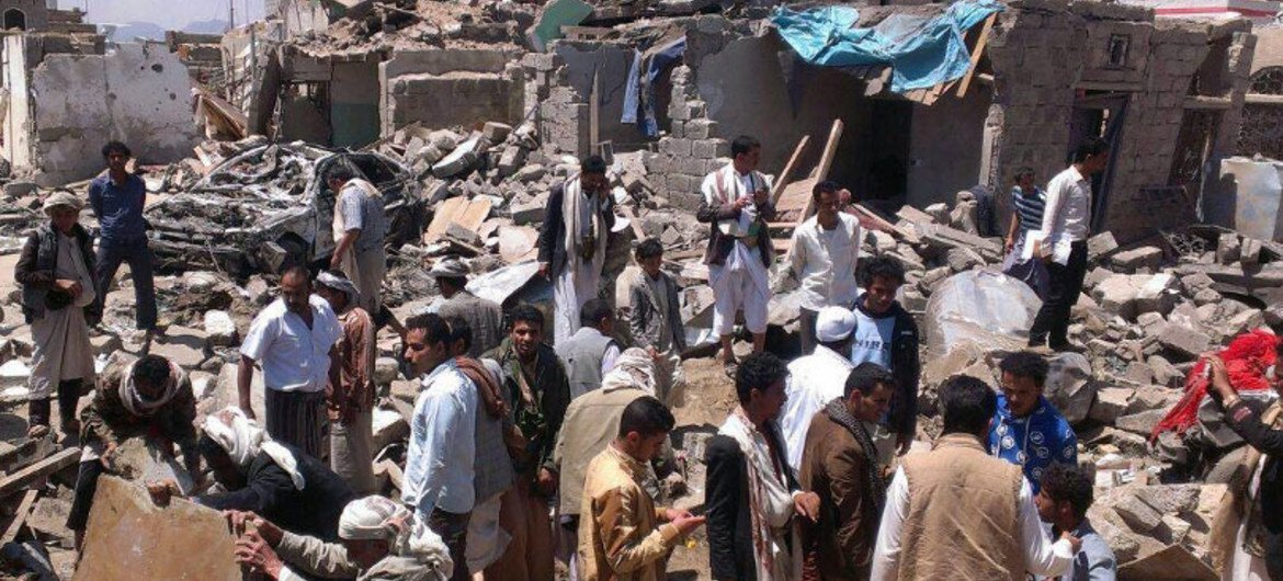 Yemenis in Sana'a search for survivors after a bombing by the Saudi-Arabia led coalition.