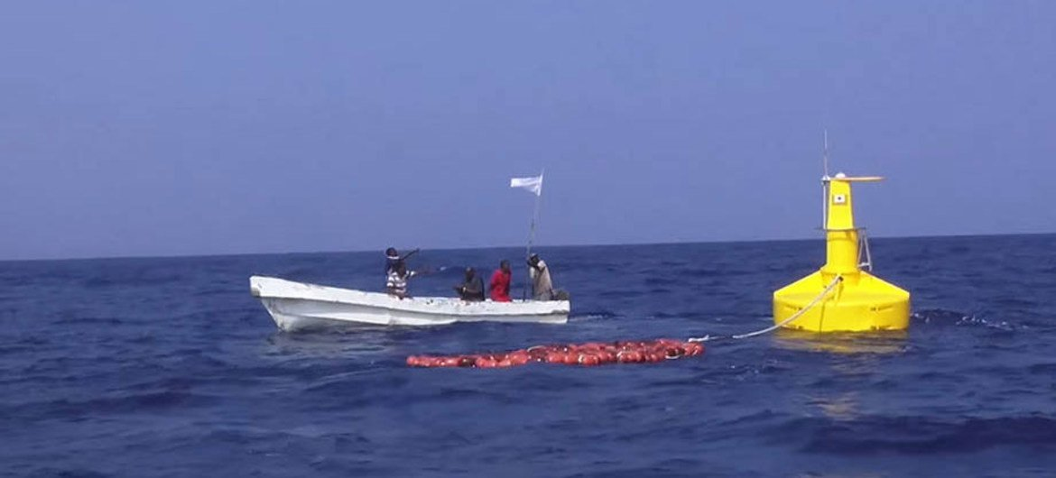 Somali fishermen near one of the new fish aggregation devices.