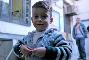 A young boy at a UNICEF winter supplies distribution centre in Damascus, Syria.