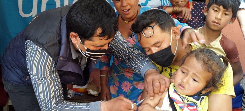 Child being vaccinated in Nangavare, Nepal.