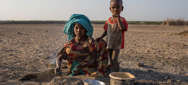 Nine-year-ole Zahara Ali cooks breakfast in a rural village in the Dubti Woreda, Afar Region, Ethiopia.