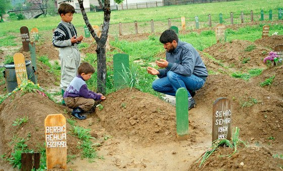 A Muslim man grieves over his son's grave in Vitez, Bosnia and Herzegovina (file photo).