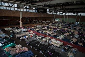 Des migrants et réfugiés dans un centre d'accueil à Berlin. Photo UNICEF/Ashley Gilbertson VII