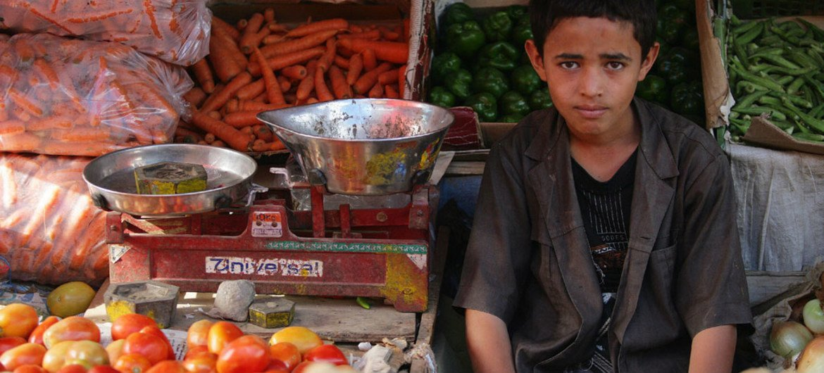 A boy sells vegetables at the Taiz Governorate Osaifera vegetable market in Yemen.