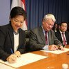 Under-Secretary-General for Peacekeeping Operations, Hervé Ladsous (centre) and Ambassador Karen Tan (left) of Singapore sign Memorandum of Understanding to work collaboratively on software development in support of UN Peacekeeping.