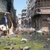 Destroyed buildings line a street – which is flooded with algae-covered, debris-filled water – in the Old City area of Homs, the capital of Homs Governorate, Syria.