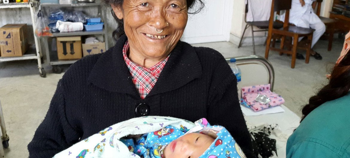 A Nepali grandmother holds her daughter's newborn baby at the UNICEF-supported Patan Hospital in Kathmandu.