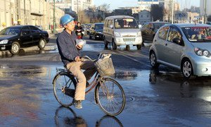 A migrant worker on his bicycle in Tianjin, China.