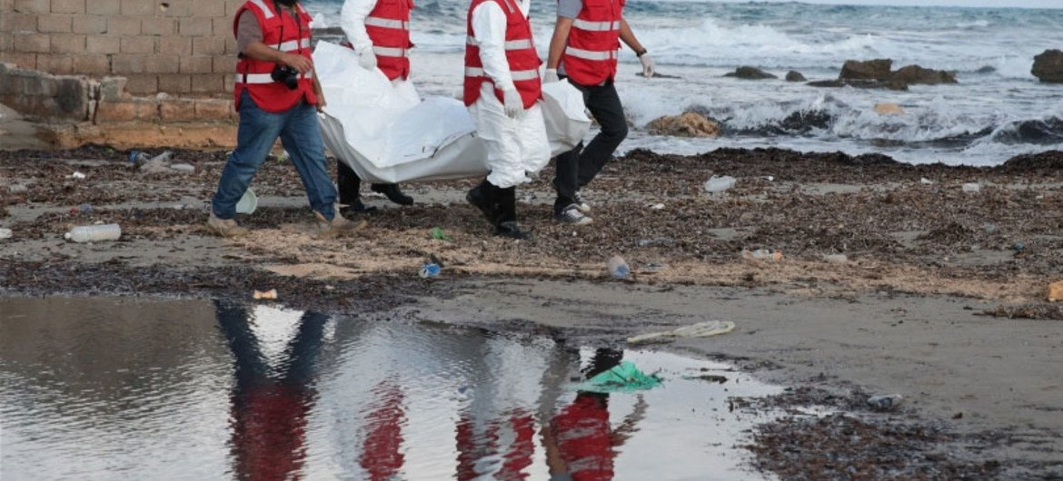 Tripoli Red Crescent teams salvage another body of a migrant, found floating in the sea water in Libya.