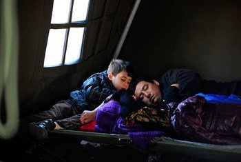 In Croatia, a refugee family rests in the UNICEF-supported Family Area at the reception centre in Opatovac.
