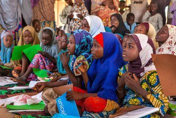 Girls use their new school supplies during a class in an informal learning centre in a UNICEF-supported safe space for children in the Dalori camp for internally displaced people, in the north-eastern city of Maiduguri in Borno State.