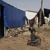 A young Syrian girl sits on a broken chair by her tent in Faida 3 camp, an informal tented settlement for Syria refugees in Bekaa Valley, Lebanon.