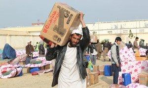 War-affected Kunduz civilians in Afghanistan receive humanitarian aid.