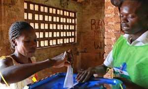 A voter casts a ballot in the election on 14 December 2015 on a constitutional referendum meant to help stabilize the Central African Republic (CAR).