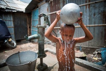 A child washes himself in Kallyanpur, a slum in Bangladesh's capital, Dhaka.
