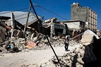 A man walks through rubble of collapsed buildings in downtown Port au Prince, Haiti, which was rocked by a massive earthquake, on Tuesday 12 January 2010, devastating the city and leaving thousands dead.