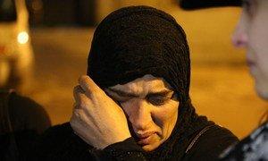 Женщина в ожидании разрешения покинуть осажденый сирийский город Мадая в окресностях Дамаска, январь 2016 г.