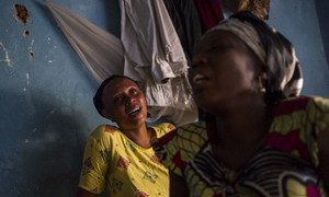 Relatives of a student killed in the Jabe neighbourhood of Bujumbura, mourn at home in the Burundian capital.