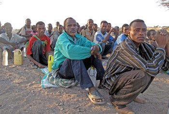 Migrants form queues to be counted by their smuggler prior to being transported by boat from Obock, northern Djibouti, to Yemen.