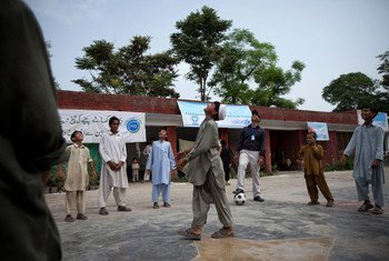Children play a game at a UNICEF-supported child friendly space in Charsadda district, Khyber-Pakhtunkhwa province, Pakistan.