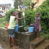 Children collecting water at a public fountain in Malabo, capital of Equatorial Guinea.