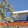 A solar heater sits atop a building.
