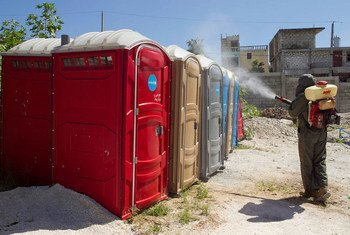 A UN peacekeeper fumigating mosquitoes in the Bel Air neighbourhood of Haiti's capital Port au Prince.