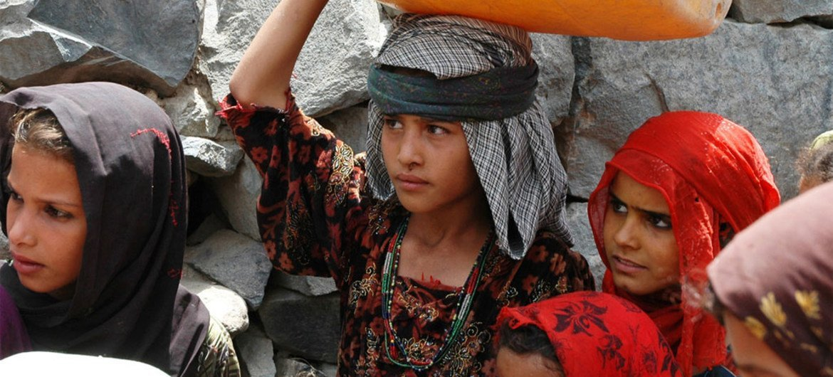 Girls fetching water in Mawyah district, Taiz. This role often falls on the shoulders of girls and young women, often at the expense of their education.