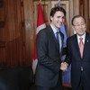 潘基文秘书长与加拿大总理特鲁多。联合国片/Evan Schneider