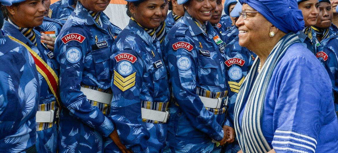 President Ellen Johnson-Sirleaf (left) with members of the all-female Indian Formed Police Unit serving with the UN Mission in Liberia in February 2016.