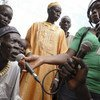 Mkazi wa Pachong huko Sudan Kusini akitoa maoni  yake wakati akihojiwa na mwandishi wa habari wa Radio Miraya ya ujumbe wa  Umoja wa Mataifa nchini Sudan Kusini, UNMISS.