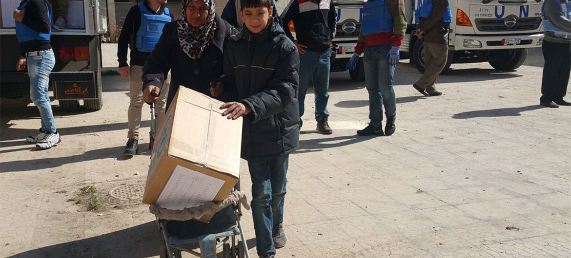 UNRWA delivers humanitarian aid to civilians in Yalda, including those displaced from Yarmouk camp in Syria.