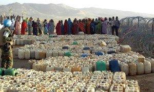 Civilians fleeing conflict in the Jebel Marra area in Sudan's Darfur region waiting for water distribution near UNAMID Team Site in Sortoni.