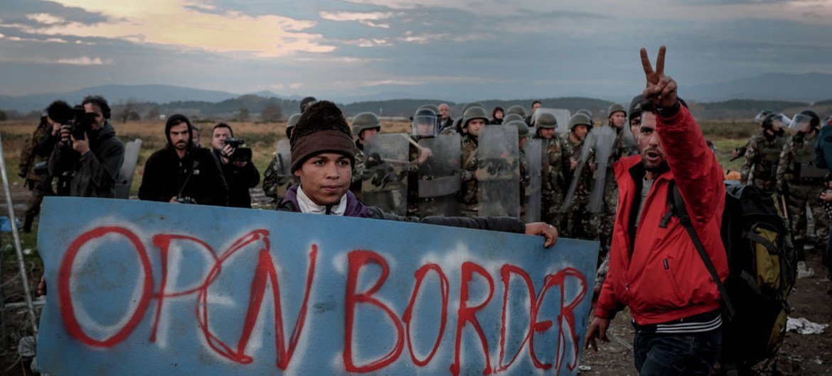In November 2015, refugees and migrants protest border restrictions near the Greek town of Idomeni, close to the border with the former Yugoslav Republic of Macedonia.