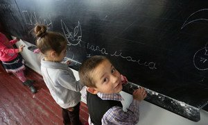 Children in a school in the village of Staromykhailovka, on the front line between the cities of Donetsk and Mariyanovka, Ukraine.