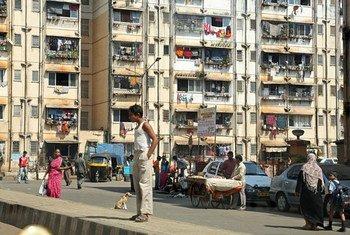 Pedestrian waits to cross in Mumbai, India.