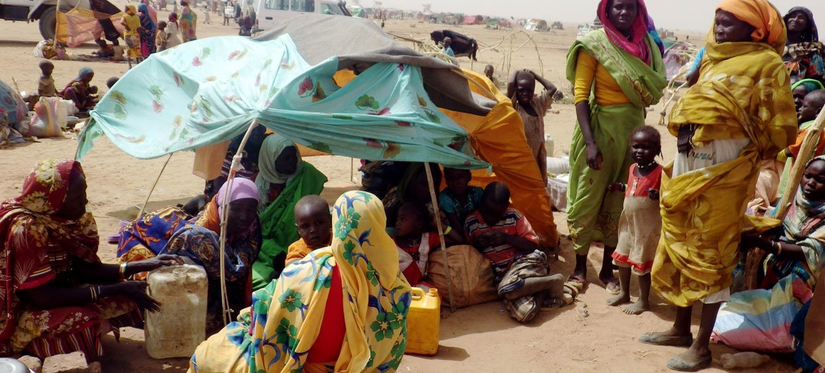 Women and children displaced from Jebel Marra, in North Darfur,  due to fighting, take shelter in the Tawilla new arrivals site.