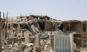 Houses destroyed by airstrikes in Yemen's capital, Sana'a, July 2015.