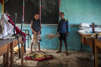 Filise, 10 (left) and Eremodo 12 (right), are in the classroom they share at Somolevu Catholic School, Vuaki Island, one of many schools in Fiji damaged during Cyclone Winston.