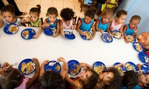 Children eat a meal at their school which is taking part in a school feeding programme in Latin America and the Caribbean.