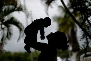 In Recife, Brazil, a 15-year-old mother holds her 4-month-old baby born with microcephaly, caused by the Zika virus.