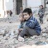 冲突后废墟中的叙利亚儿童。儿基会图片/Al-Issa