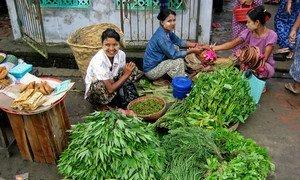 Women selling vegetables in a market in Pyapon, Myanmar.