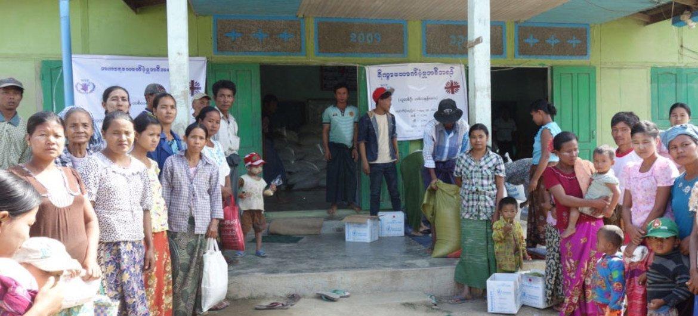 Waiting for food in Kyauk Kar village in Sagaing, Myanmar.