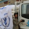 WFP trucks loaded with wheat grain, oil and salt are ready to leave for Amran, a hundred kilometres north of Yemen's capital, Sana'a.