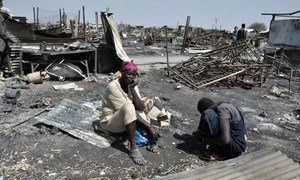 Displaced women sit in the ashes of their shelter which was burnt during the fighting and fires on 17 and 18 2016 February in the UN Protection of Civilians site in Malakal, South Sudan.