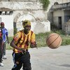 A girl passes a ball during a drill at basketball training session in Mogadishu, Somalia in 2013. Banned under the extremist group Al Shabaab, basketball is once again making a resurgence in Mogadishu.
