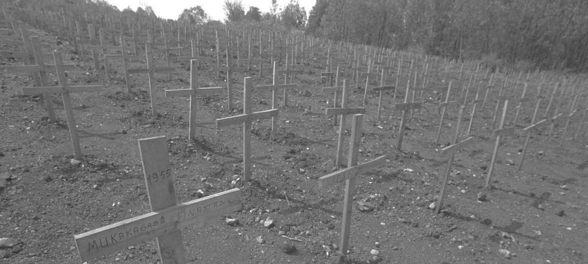 In 1996 in Rwanda, wooden crosses mark the graves in a cemetery in the village of Nyanza in a rural area of Kigali, the capital. During the 1994 genocide, over 10,000 people were burned to death in Nyanza as they tried to escape towards Burundi.