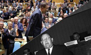 Secretary-General Ban Ki-moon bows to the General Assembly after his re-appointment in 2011 as the eighth Secretary-General (top). The first Secretary-General Trygve Lie speaks at the Palais des Nations in Geneva, 1950.